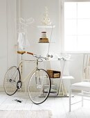 Bicycle, coat stand and chair in white interior