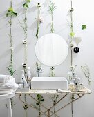 White bathroom with flowers and leaves on wall