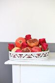 Pomegranates and roses on vintage tray