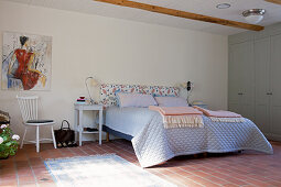 Rustic bedroom with terracotta floor tiles