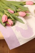 Pink tulips on hand-sewn tea towel with Easter motif