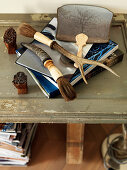 Brushes with horn handles and books stacked on table