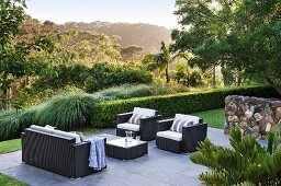 Elegant outdoor furniture on a paved terrace area