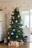 Presents under Christmas tree decorated with stars