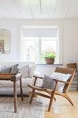 Retro wooden armchair in Scandinavian living room