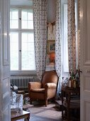 Old leather armchair and drinks trolley in classic lounge