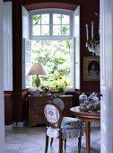 Open window overlooking garden in historical stately home