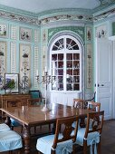 Historical dining room with painted walls in stately home