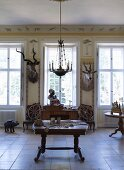 Interior decorated with African hunting trophies in stately home