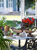 Gardening tools on table in garden