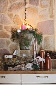 Advent arrangement with four candles in vintage metal bucket