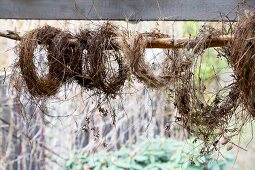Hay wreaths hung from wooden pole