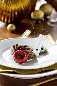 Small chocolate rings and mini wreath used as name tag on plate