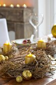 Festive table decorated with dried wreaths and gold candles