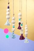 Pendants made from wooden beads and tassels