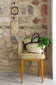 Shopping bag on chair in front of Mediterranean mosaic wall