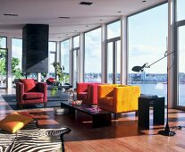 Lounge with glass walls and view of lake