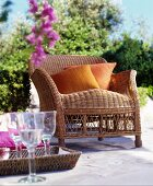 Wicker armchair with cushions on Mediterranean terrace