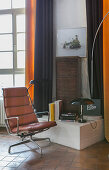 Swivel chair with leather cover and designer furnishings in living room