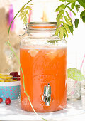 Orange drink in glass drinks dispenser
