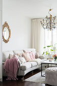 White sofa with cushions and coffee table in bright living room