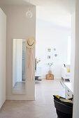Mirror in hallway leading into open-plan interior