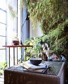Two side tables in front of bamboo plant
