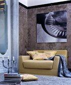 Mustard-yellow sofa below modern photographic art on marble wall