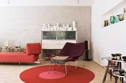 Retro furniture and collection of vases in living room with concrete wall