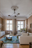 Brown walls and stucco ceiling in living room of period apartment