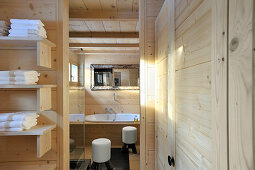 Bathroom with wood-clad walls and ceiling