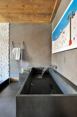 Square stone trough used as sink in modern bathroom