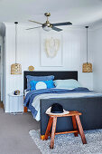 Double bed with head and foot end, ceiling fan above in the bedroom