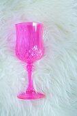 Pink crystal glass on sheepskin