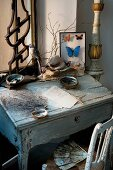 Vintage arrangement of desk, writing paper and framed mounted butterflies