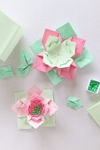 Origami flowers made from paper of various colours and beads