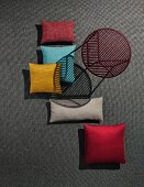 A side table and decorative cushions made of outdoor fabrics