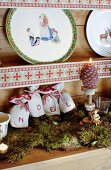 Festively decorated Alpine-style plate rack
