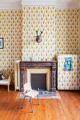 Patterned wallpaper and fireplace in children's bedroom in period apartment