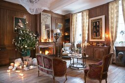 Christmas tree, antique furniture and open fire