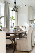 Elegant dining area in bright country-house kitchen
