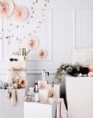 Gift ideas arranged on white plinths