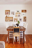 Rustic dining table with chairs and photos in vintage wooden boxes