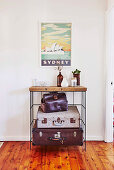Vintage shelf with suitcases, above with picture with 'Sydney' motif