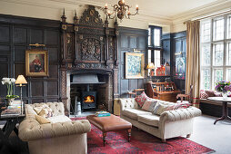 Historical panelled wall and open fireplace in living room
