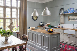 Country-house kitchen-dining room with dining table and lattice window