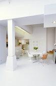 Designer furniture and open-plan kitchen in modern dining room