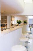 White open-plan kitchen in modern architect-designed house