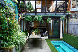 Small courtyard garden with mini pool and vertical planting