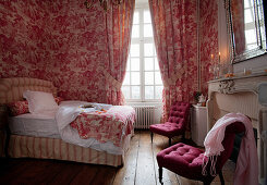 Red and white toile de jouy pattern in historical bedroom